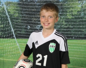 Kid posing for a soccer photo