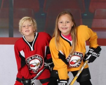 Two kids posing for a hockey photo